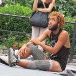 Homeless man wearing legwarmers