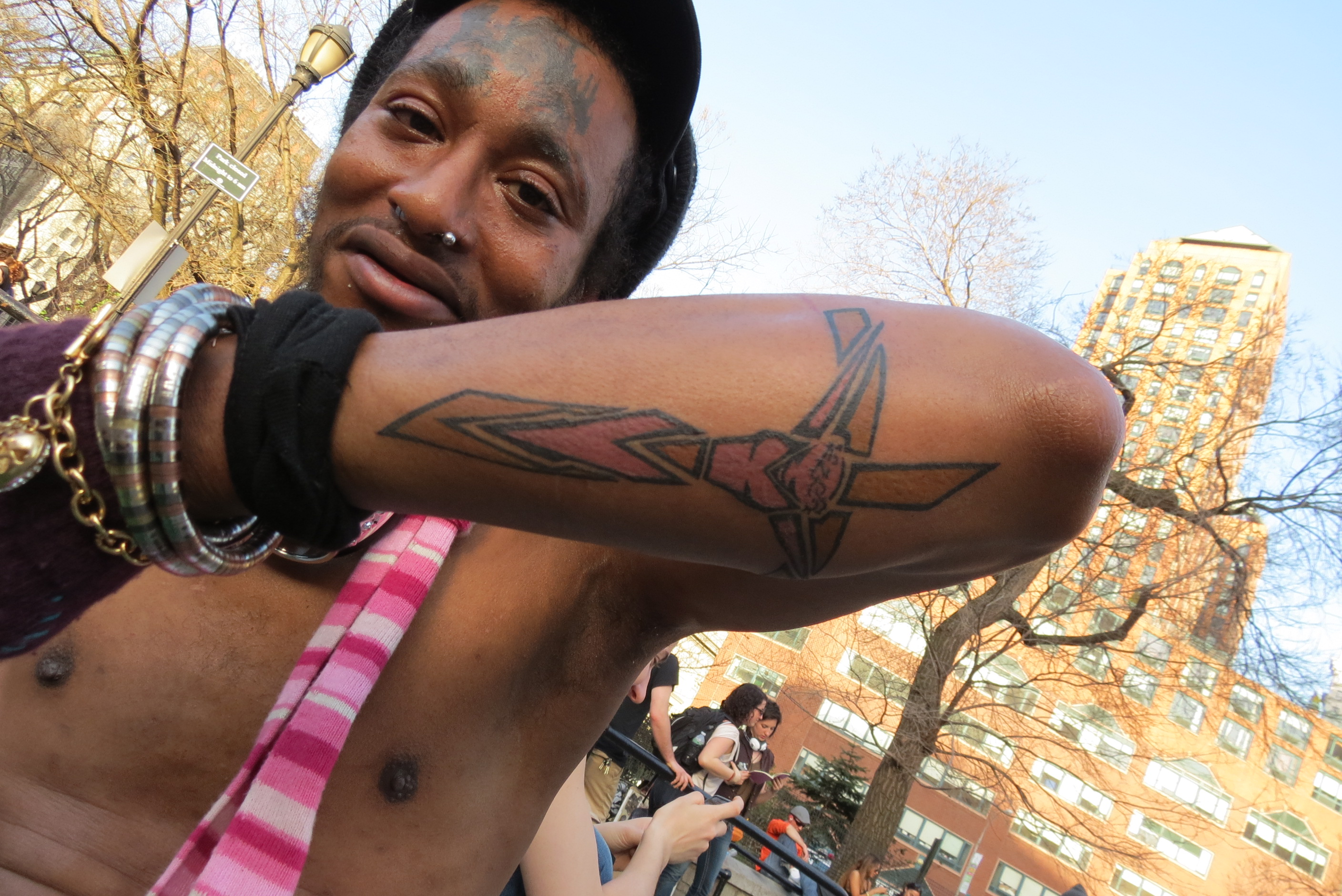 Black weird man with tattoos
