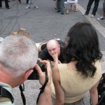 Creepy guy kissing bottom of woman's foot in public