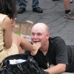 creepy man with woman's foot in mouth