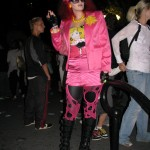 red haired woman in pink