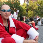 Man dressed as Santa and shades