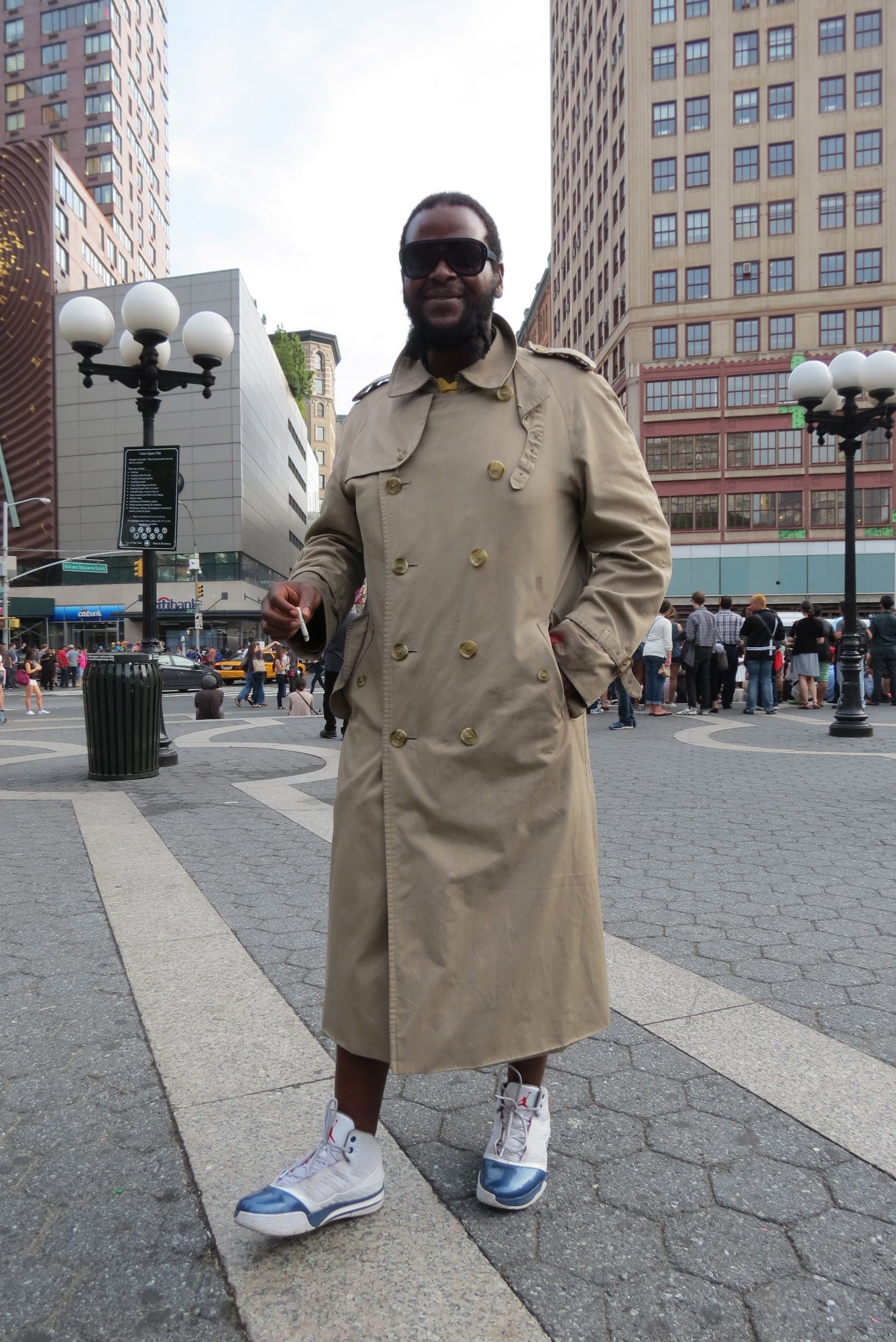 Man poses in overcoat