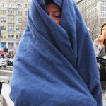 woman wrapped in blue blanket