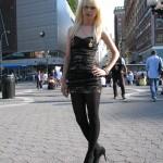 blonde in tight black dress