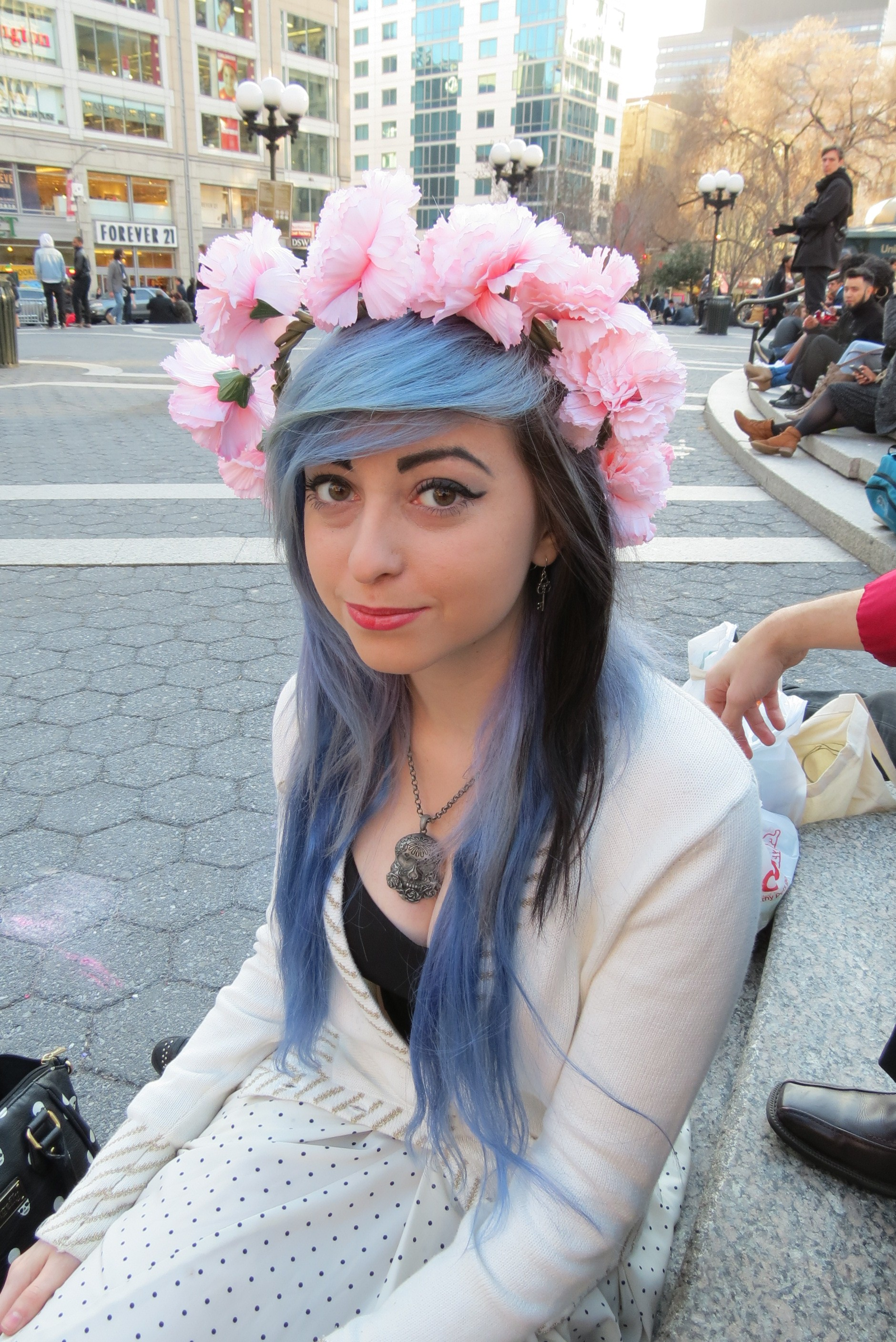 Black & blue haired girl with crown of pink flowers