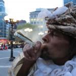 Homeless man Wendell smoking dollar bill