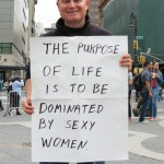 man with funny sign