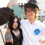 Goth girl with street performer