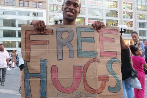 Boy with Free Hugs sign