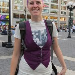 happy girl with purple hair and vest