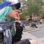 Sasha smoking her cigarette at the Square