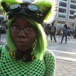 Black girl in green wig & cat ears