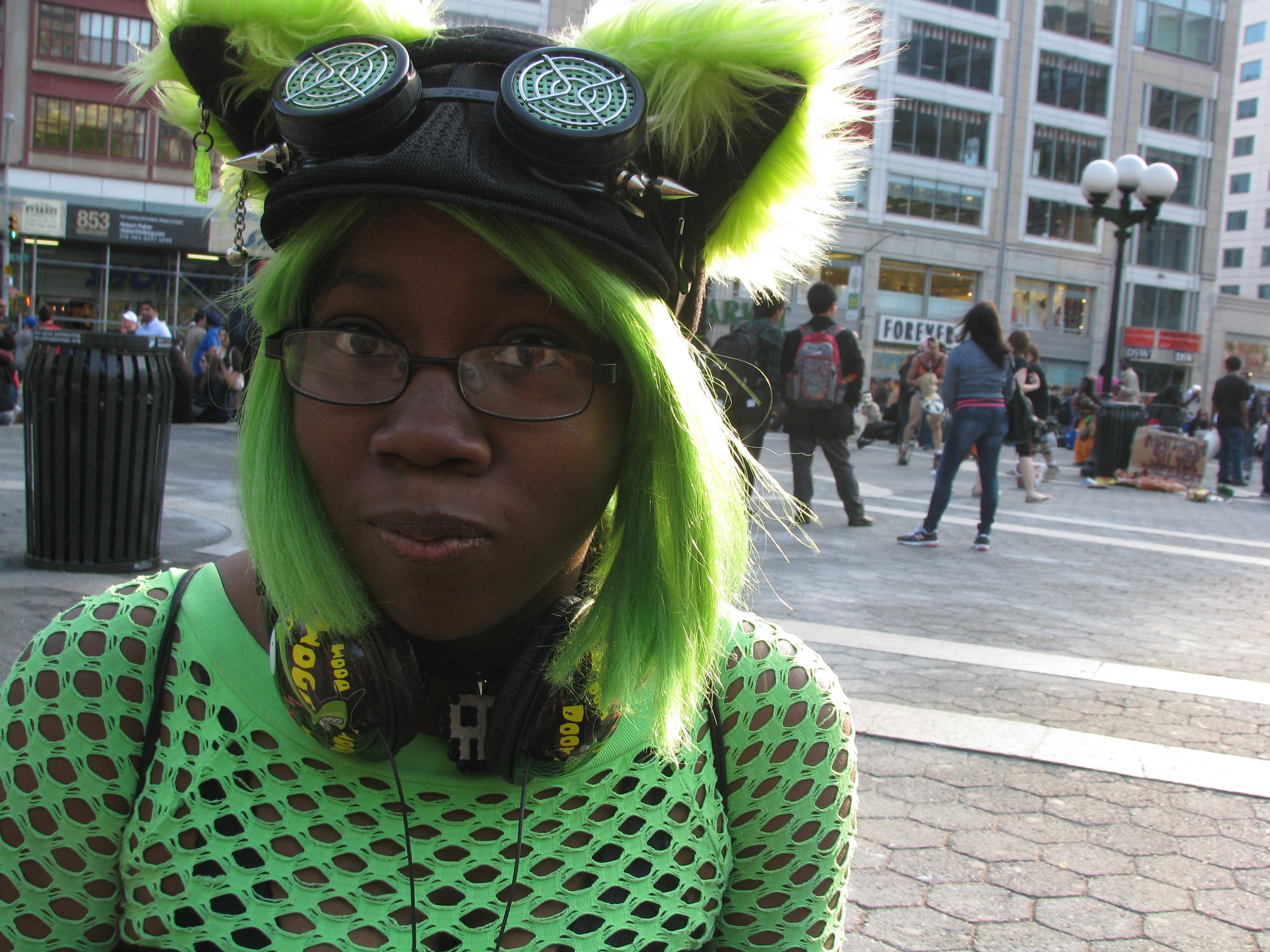 Black girl in green wig & cat ears