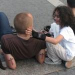 Child touches bald head