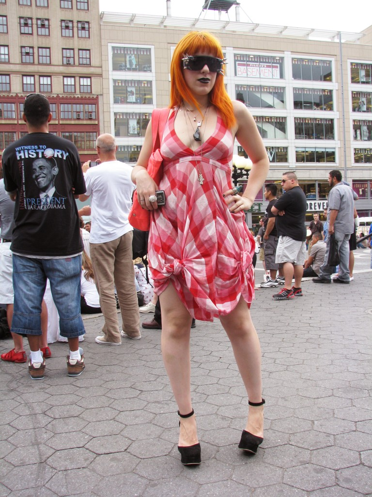 Redheaded woman in spiked sunglasses