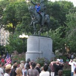 Man dressed as Superman climbs washington statue at union square