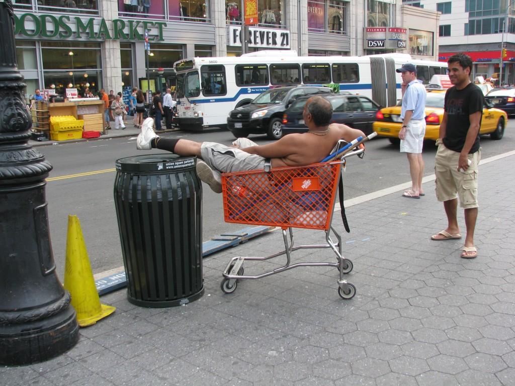 Man lounging in Shopping Cart Aug 24, 2009