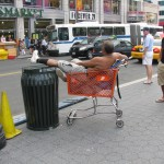 Man lounging in Shopping Cart Aug 24, 2009