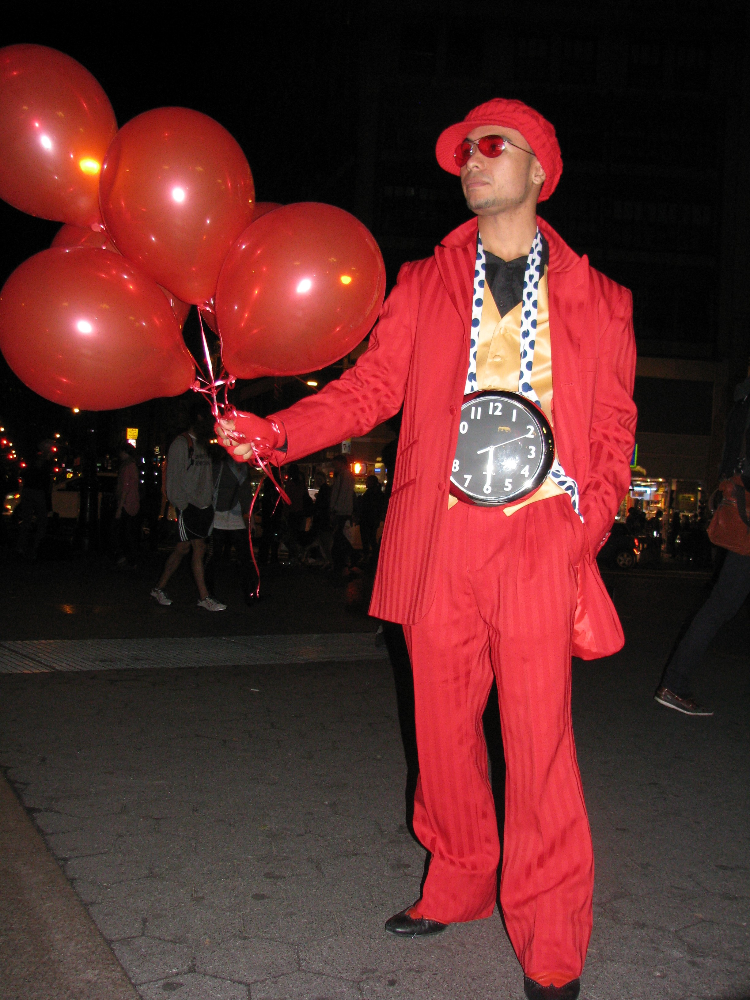 Man dressed in red with balloons