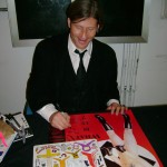 Crispin Glover laughing nervously at offensive magnets