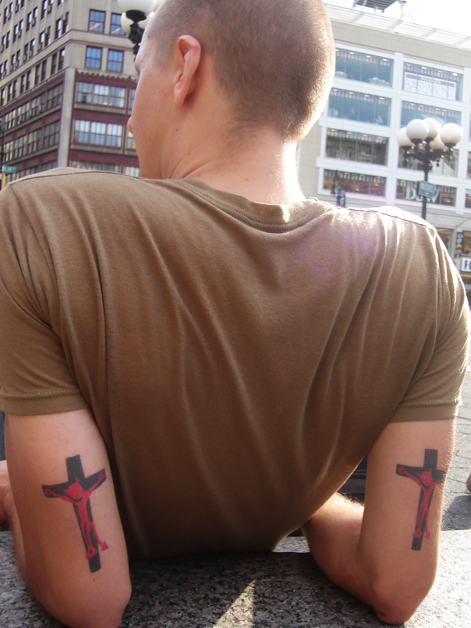 man with Crucified Satan tattoos