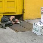 Homeless punk asleep on street