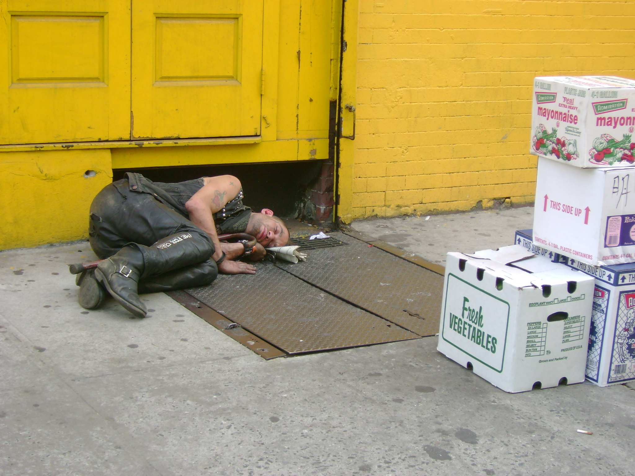 Homeless punk asleep on street