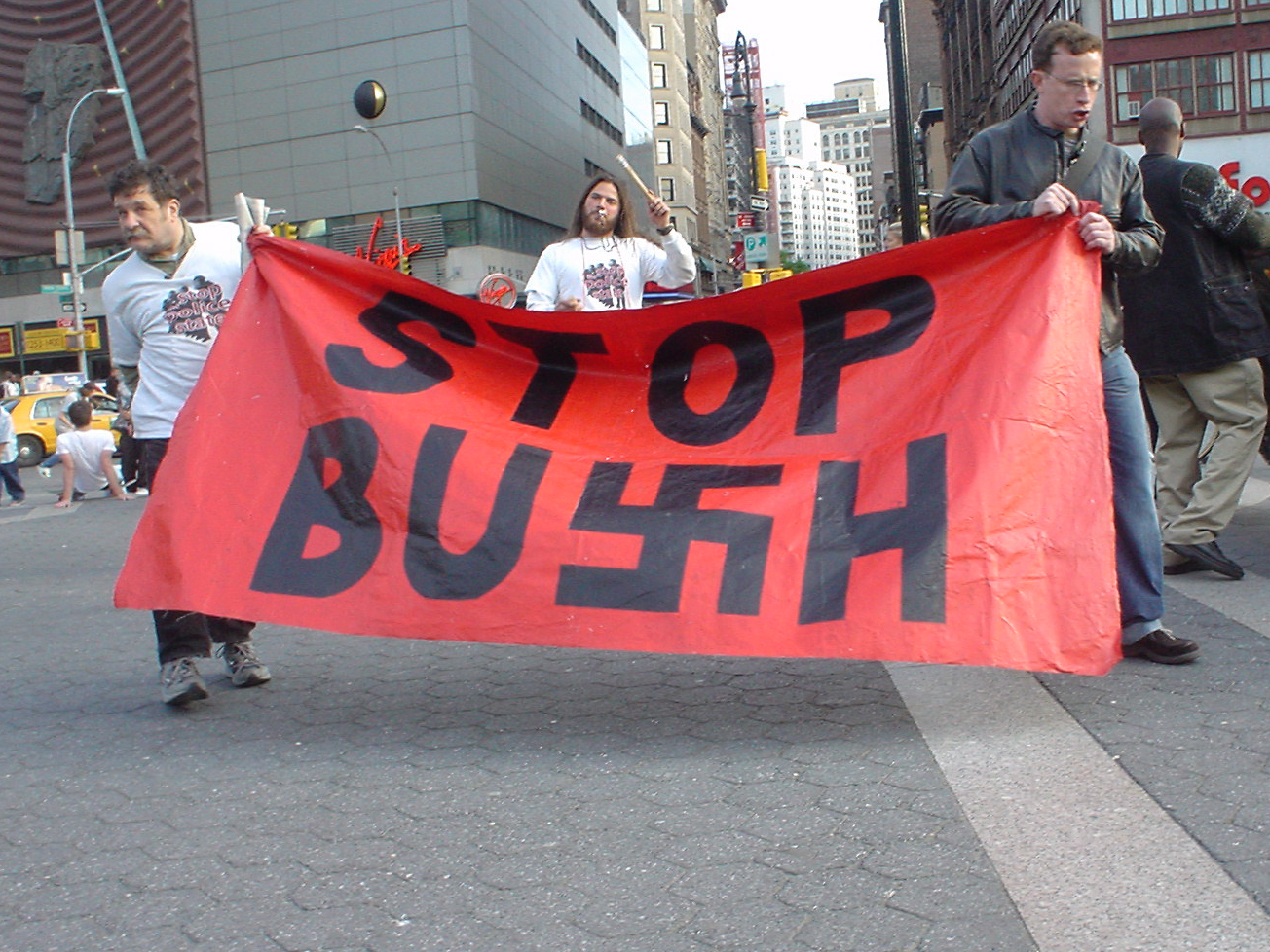 Demonstrators with STOP BUSH sign
