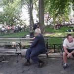 White Man watching Black Man Arrested