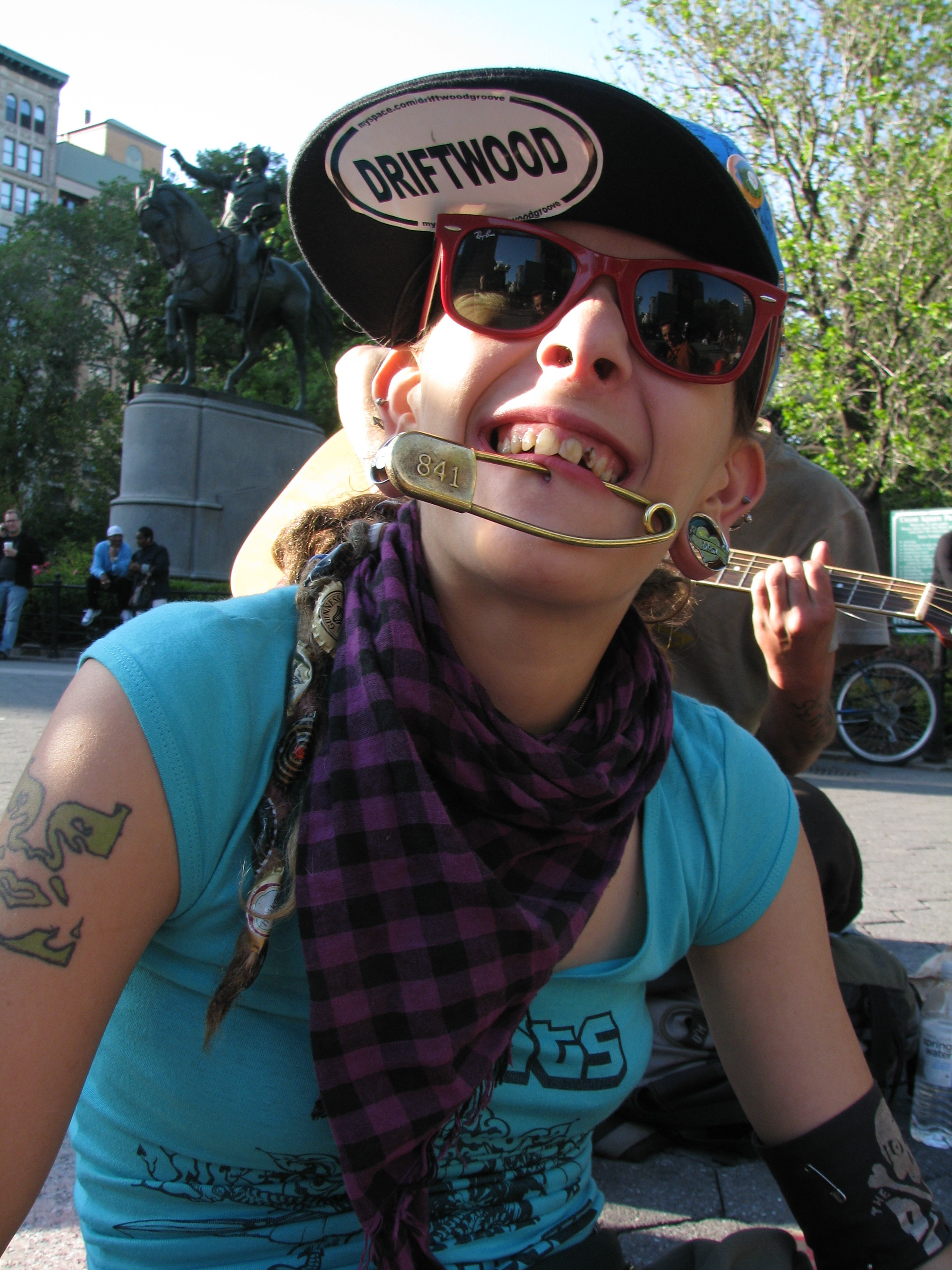 girl with giant safety pin through lip