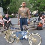 Cholo with lowrider bicycle