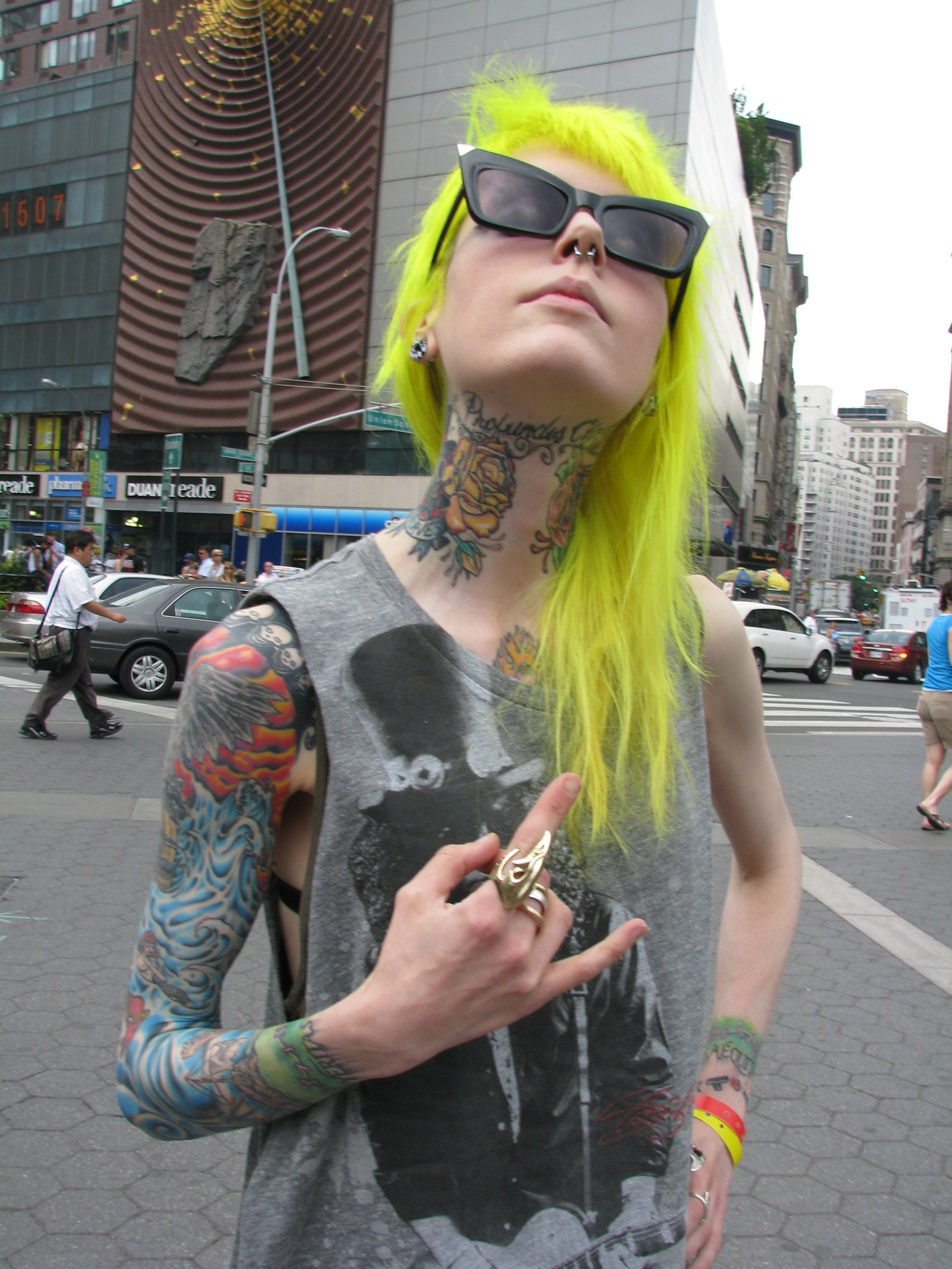skinny punk tattooed girl with bright yellow hair