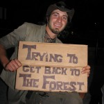 handsome poor man holding sign