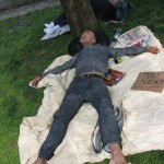 homeless man sleeping in park