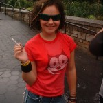 young girl in sunglasses and cigarette