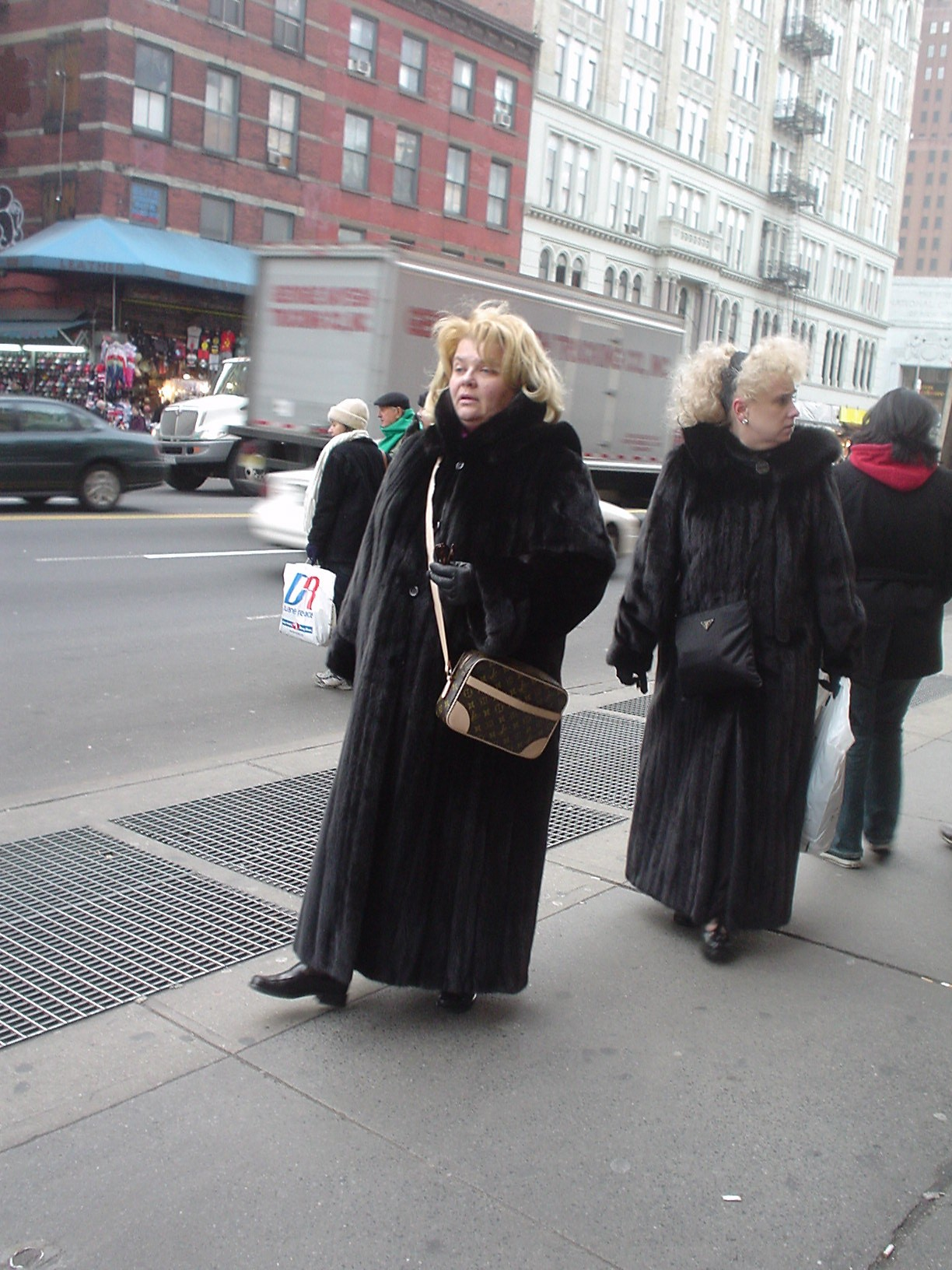 Blonde women in black fur coats