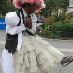 homeless fashion designer in pink feathered hat