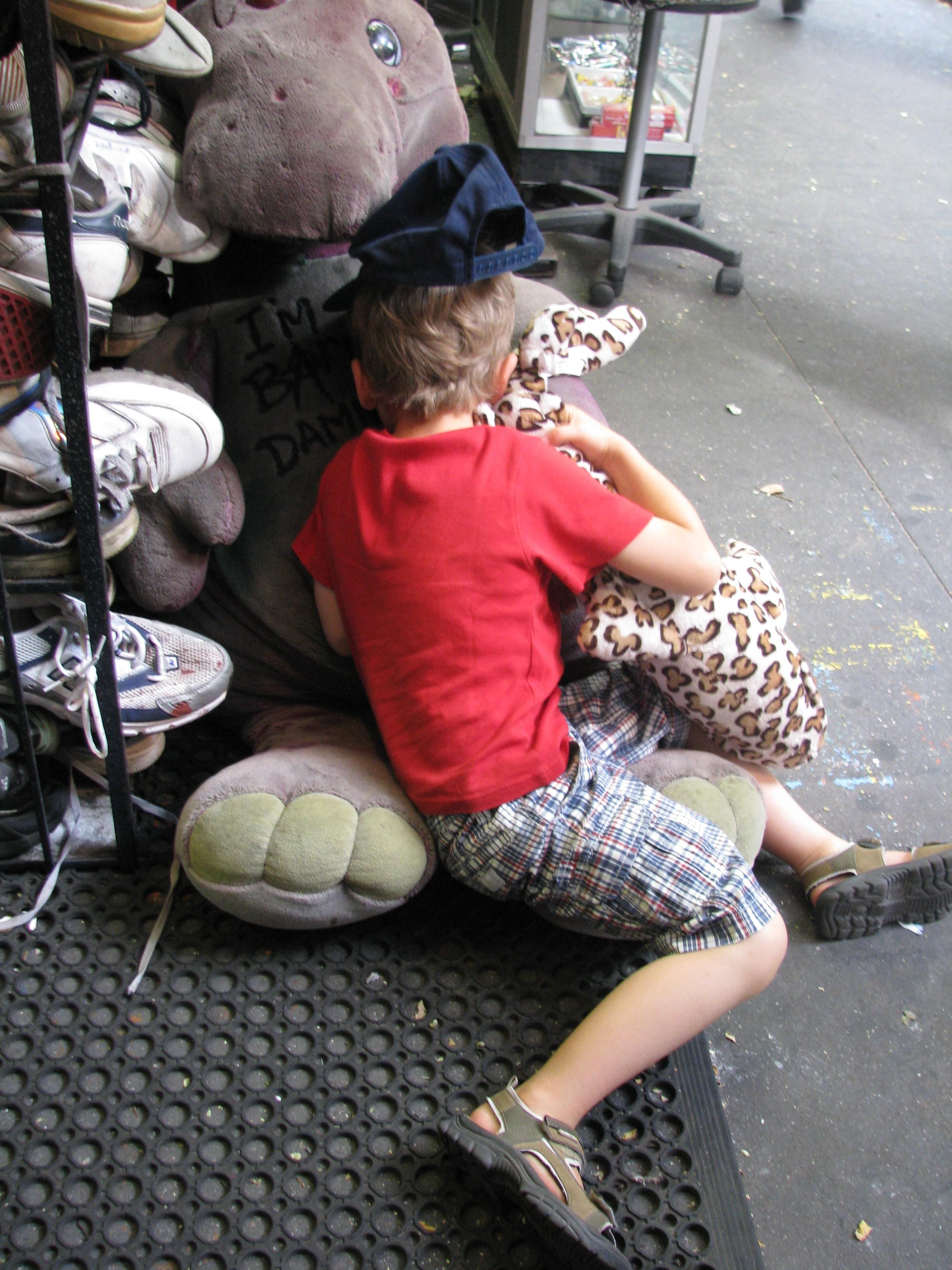 Kid hugging Barney Toy
