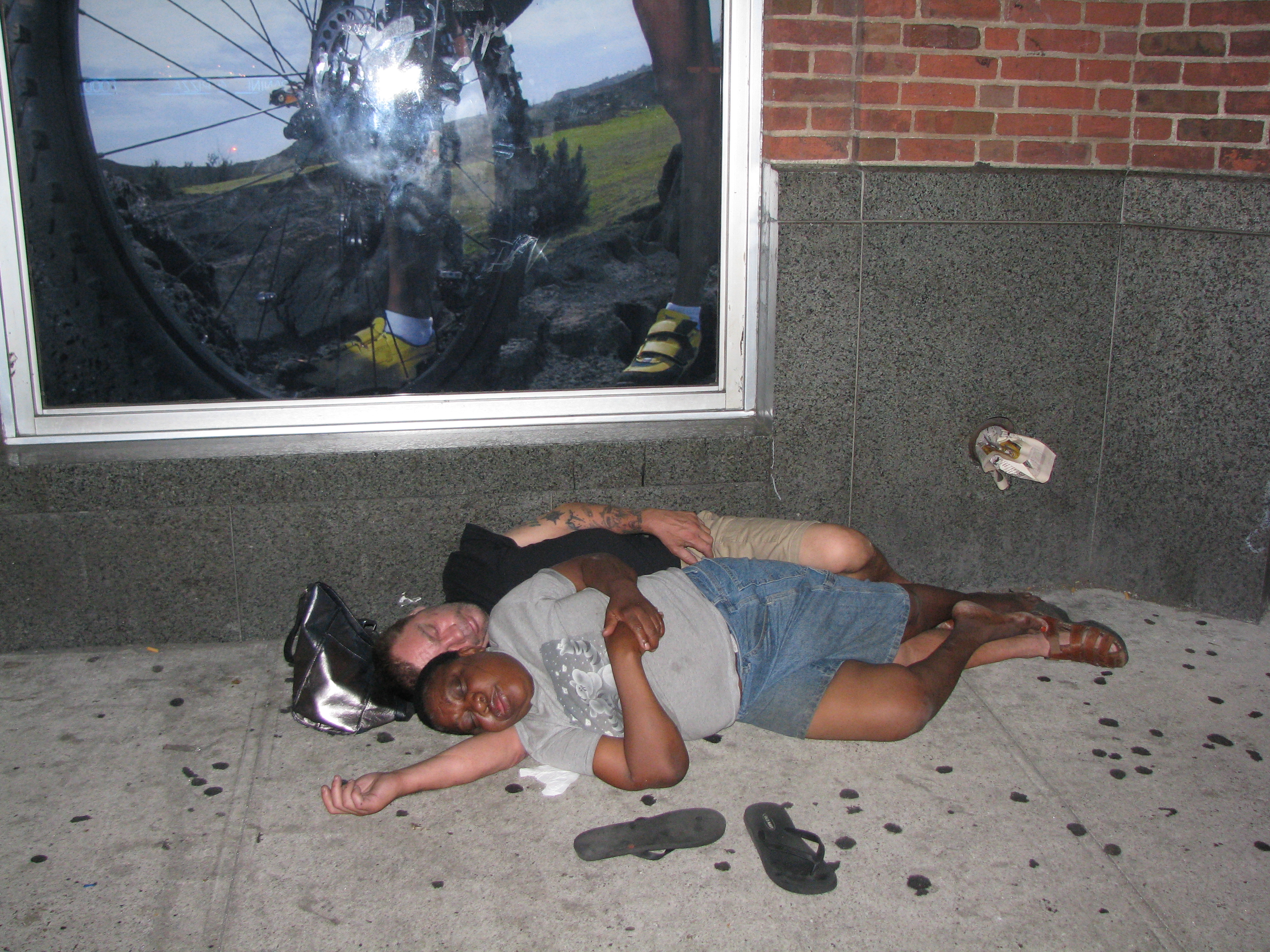 Homeless couple sleeping