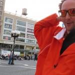 Lotion Man in orange coat