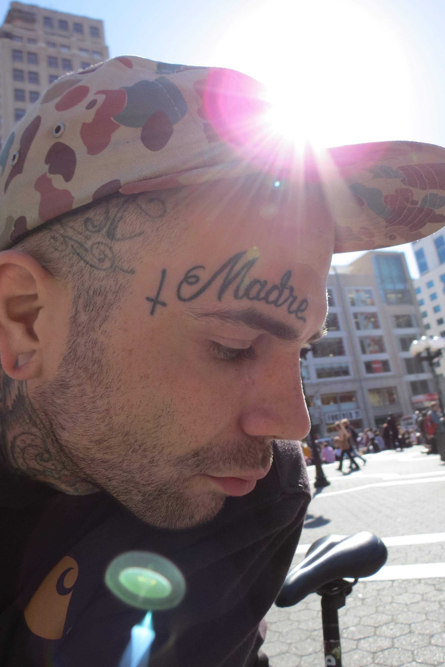 man with facial tattoos