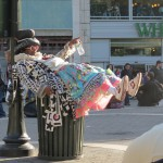Wendell Headley lying on garbage can
