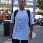Man wearing shirt with Swastika & other symbols