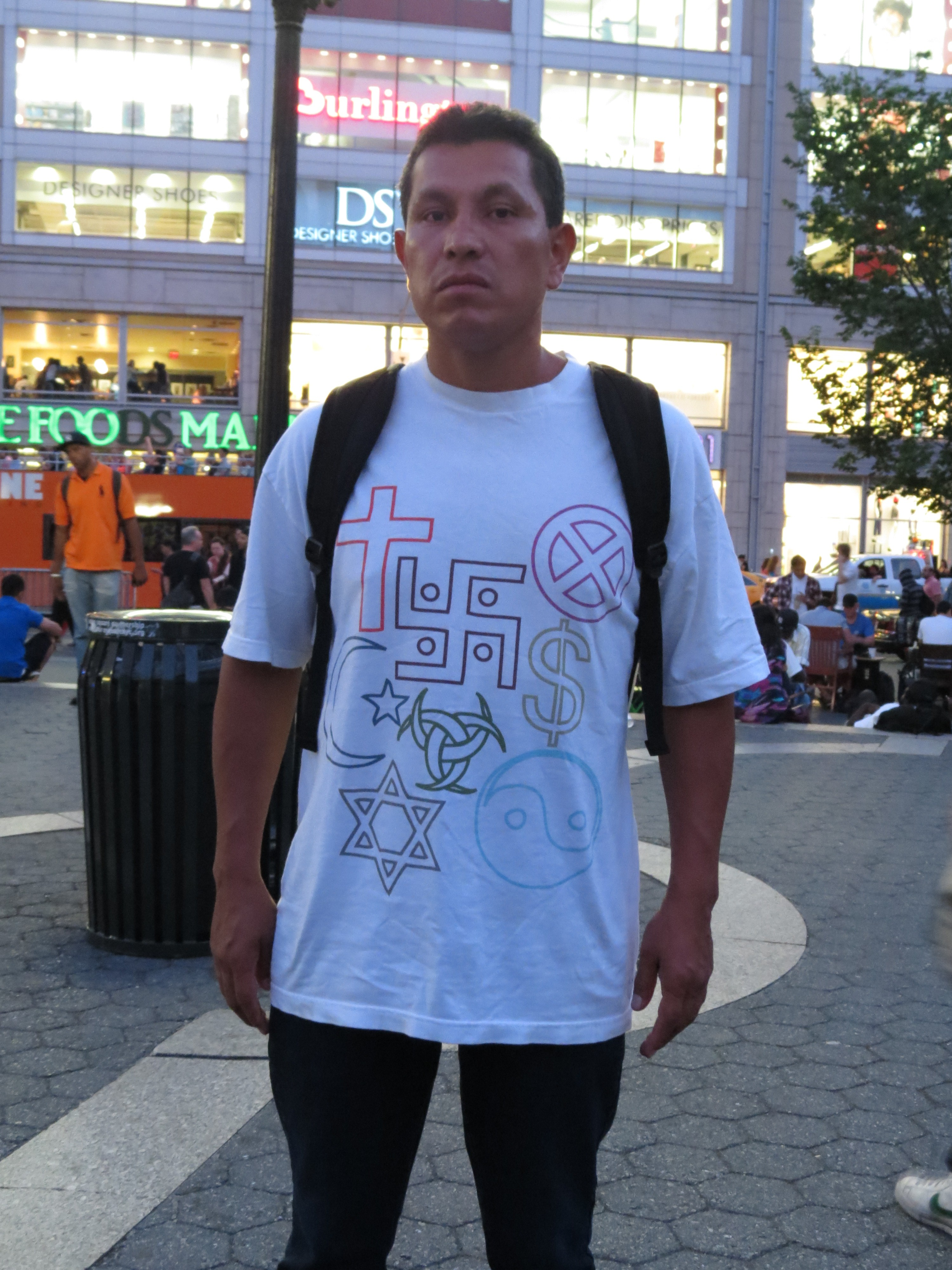 Man wearing shirt with Swastika & other symbols