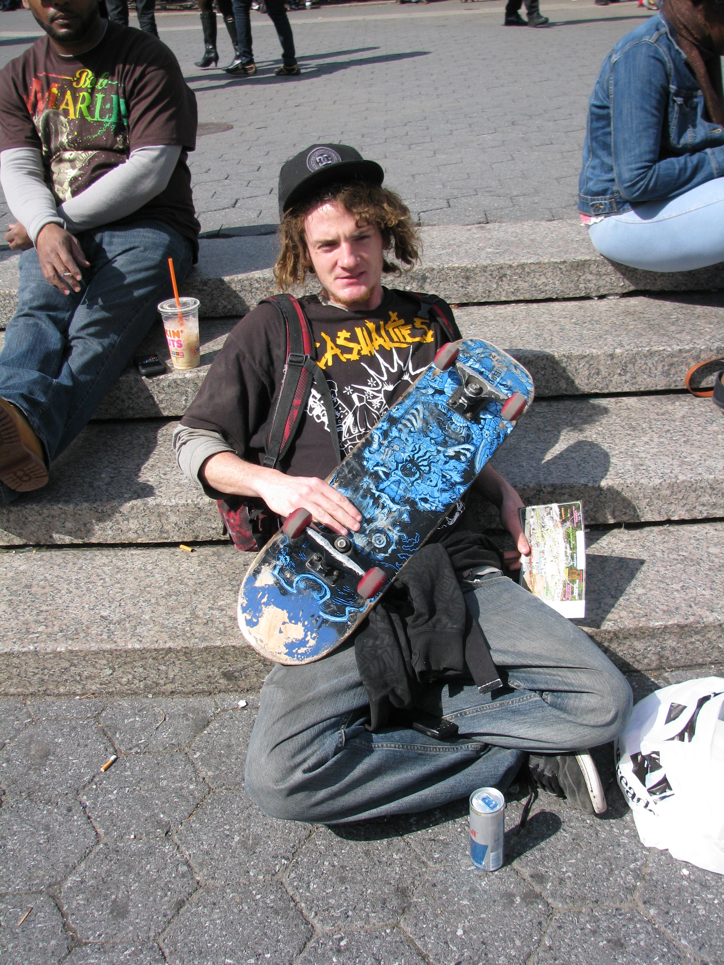 skater with dreadlocks with board