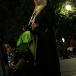 Muslim woman with phone tucked in headdress