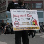 Man w/May Judgment Day sign