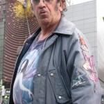Jeffrey Babbitt poses in front of smoking art