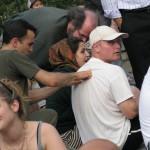 man massaging man at park